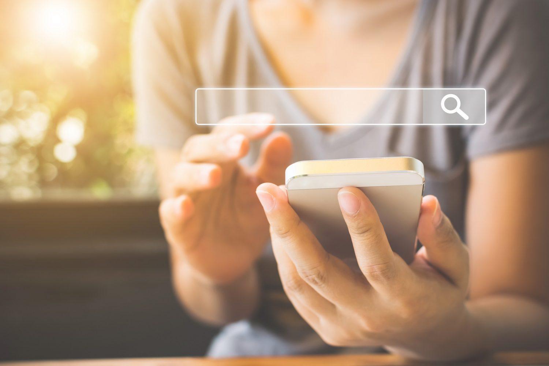 Woman Using Smartphones to Google
